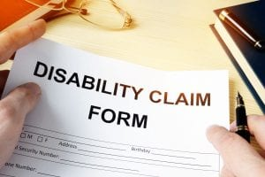 man holding disability claim form